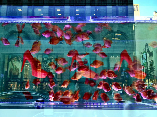 Barneys fish in the tank window display 2012 best window for Fishing store nyc
