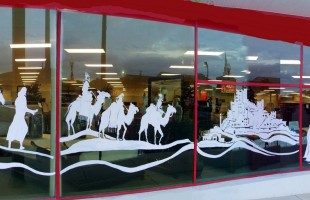 The 3 Wise Men Painted on Badcocks Home Furniture & More Window Display