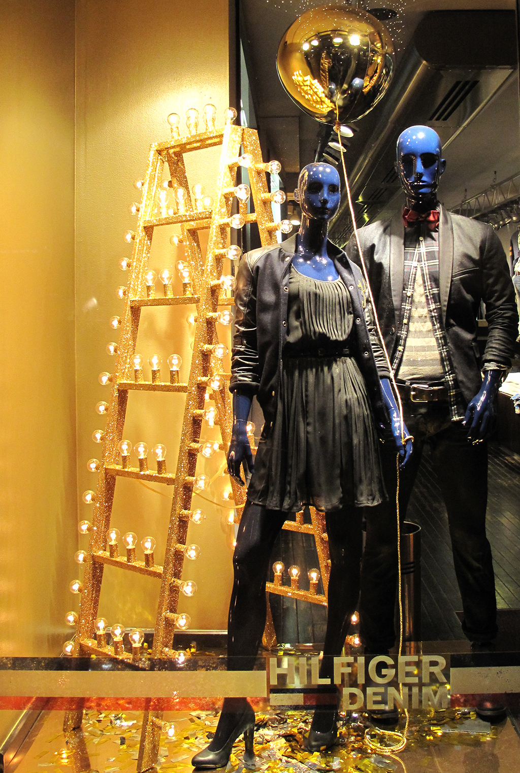 Hilfiger denim used props like a golden ladder with lamps and golden - Deck The Holiday S 12 23 13